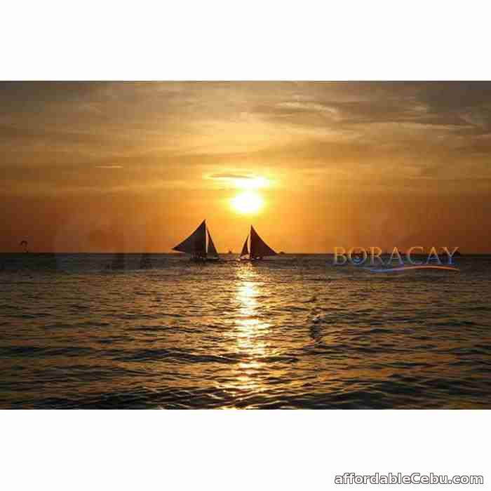 1st picture of Boracay package, with its ocean full of romantic paraws during sunset Offer in Cebu, Philippines