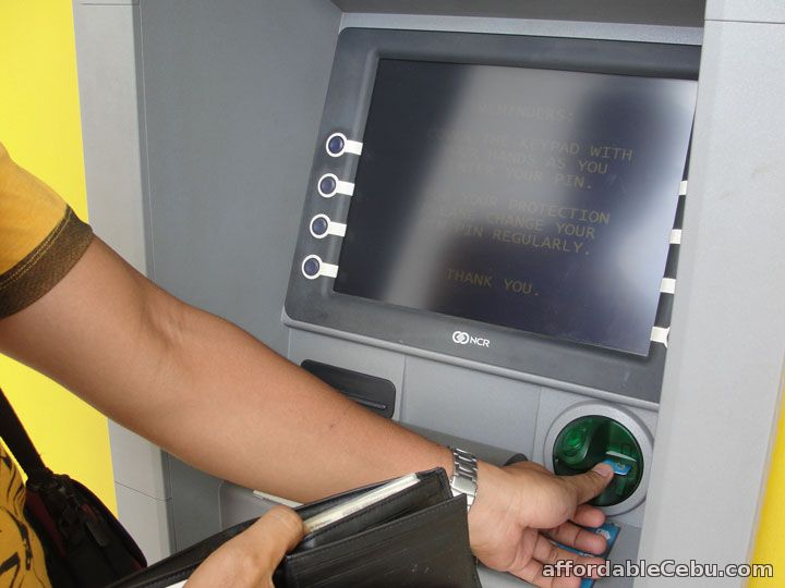 Insert ATM card to ATM Machine