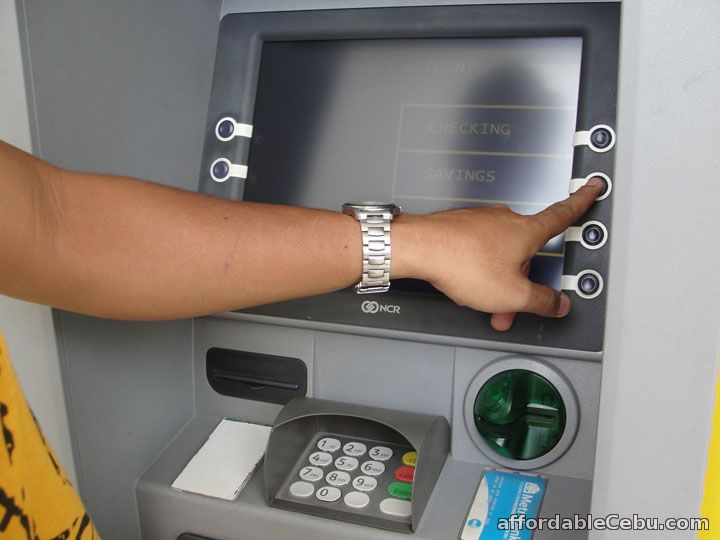 Withdraw money ATM machine-savings